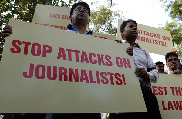 On February 17, 2016, Indian journalists shout slogans during a protest to condemn an assault on fellow media workers by lawyers at a court in New Delhi. (Indranil Mukherjee/AFP/Getty Images)