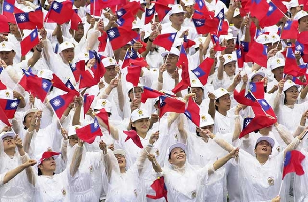 Taiwanese people wave the national flag during a gathering on the square by the Presidential Office in Taipei to celebrate the island's National Day in 2005. (Patrick Lin/AFP/Getty)