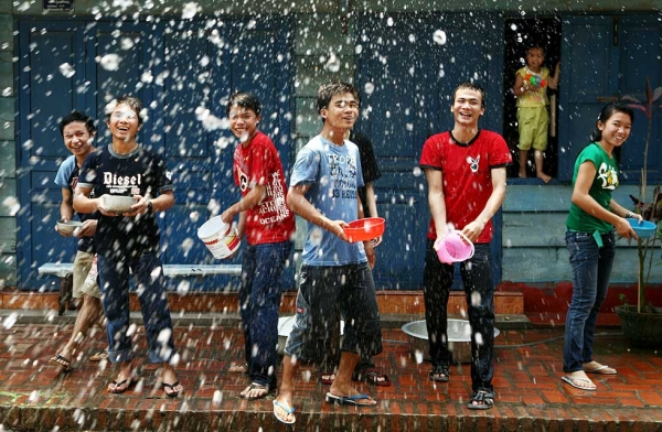 Young people line up to splash water on each other during the Songkran festival on April 13, 2008, in Luang Prabang, Laos. (Chumsak Kanoknan/Getty Images)