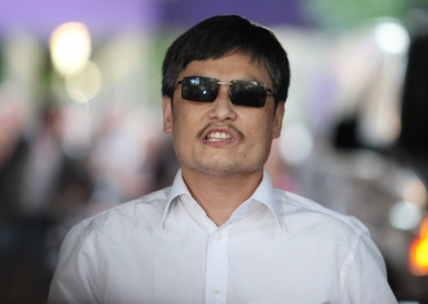 Blind Chinese activist Chen Guangcheng makes remarks to the media upon arriving on the campus of New York University on May 19, 2012 in New York City. (Andy Jacobsohn/Getty Images)