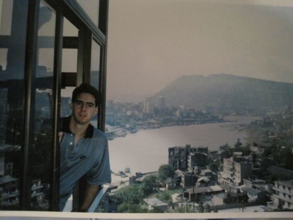Peter Hessler in his apartment in Fuling, China, in the fall of 1996 shortly after he arrived. His apartment looked down to the Wu River and then the Yangtze in the distance. The main city of Fuling is visible to the left, at the juncture of the rivers.