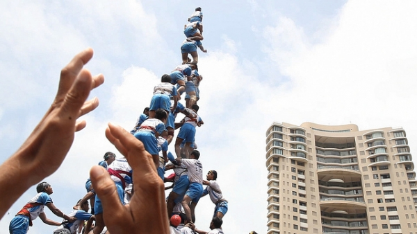 "A team of men in India balance and reach toward the sky in the documentary ""The Human Tower."" (Goldcrest Films International)"