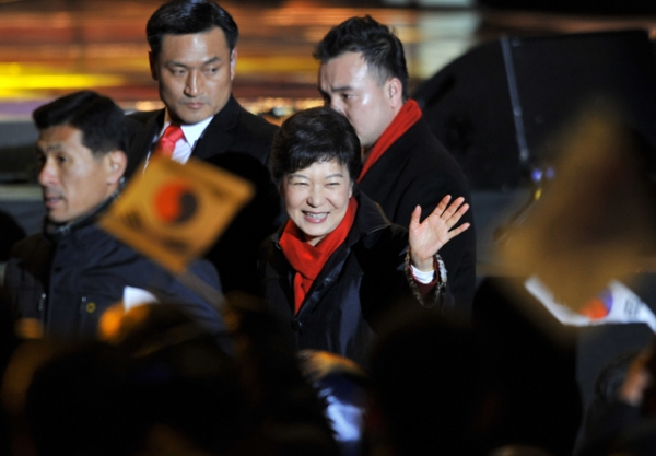 South Korea's president-elect Park Geun-Hye waves to supporters as she arrives to deliver a victory speech on a stage in the centre of Seoul on December 19, 2012. (Jung Yeon-Je/AFP/Getty Images)
