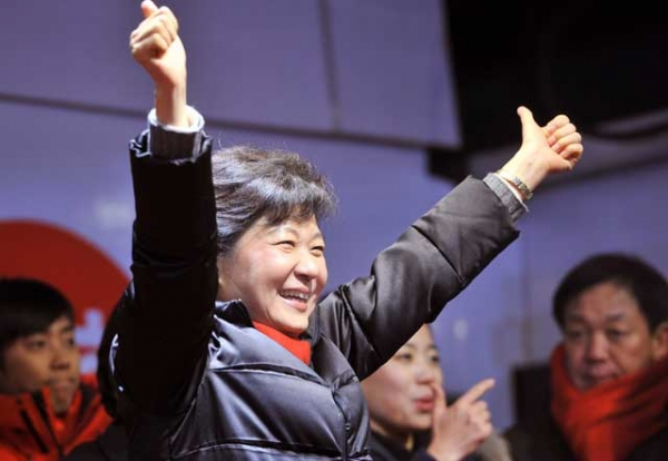 South Korean presidential candidate Park Geun-hye (C) of the ruling New Frontier Party waves to her supporters in Seoul on Dec. 18, 2012, one day before her historic victory. (Jung Yeon-Je/AFP/Getty Images)