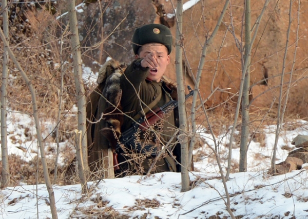 A North Korean soldier reacts as he patrols along the Yalu River, near the North Korean town of Sinuiju, after the country conducted its third nuclear test on February 12, 2013. (Mark Ralston/AFP/Getty Images)