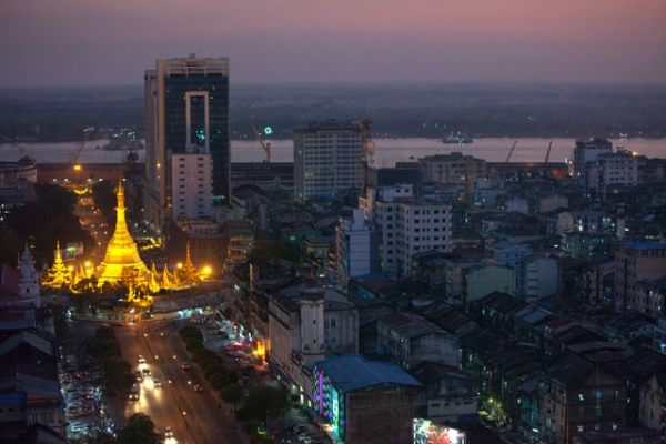 Rush hour traffic moves near by the Sule Pagoda at dusk December 14, 2011 in Yangon, Myanmar. (Paula Bronstein/Getty Images)