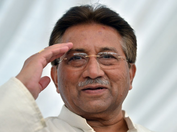 Former Pakistani president Pervez Musharraf saluting as he arrived to unveil his party manifesto for Pakistan's April general election at his residence in Islamabad on April 15, 2013. (Aamir Qureshi/AFP/Getty Images)