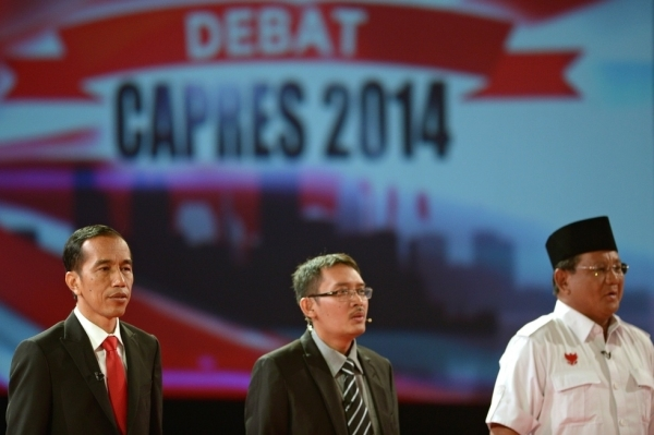 Indonesian presidential candidates Joko Widodo (L) and Prabowo Subianto (R) attend the second presidential debate in Jakarta on June 15, 2014. Campaigning for Indonesia's July presidential election officially kicked off on June 4, with favourite Joko Widodo facing a tough challenge from a Suharto-era former general with a chequered human rights record. (Adek Berry/AFP/Getty Images)