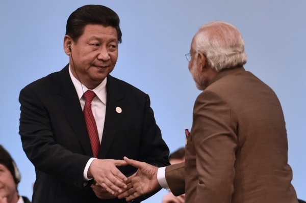 China's President Xi Jinping (L) shakes hands with India's Prime Minister Narendra Modi during the 6th BRICS Summit in Fortaleza, Brazil, on July 15, 2014. (Yasuyoshi Chiba/Getty Images)