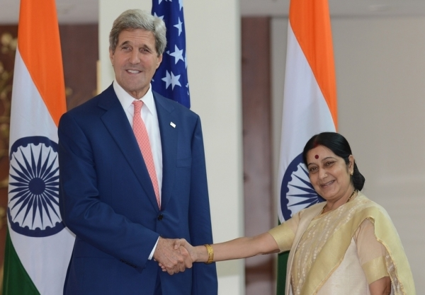 U.S. Secretary of State John Kerry (L) shakes hands with Indian Minister for External Affairs Sushma Swaraj during a meeting in New Delhi July 31, 2014. (Raveendran/Getty Images)