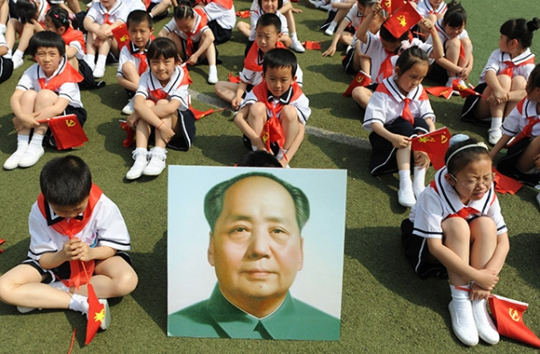 Children in Taiyuan, China in 2011 celebrate the 90th anniversary of the founding of China's Communist Party. (STR/AFP/Getty Images)