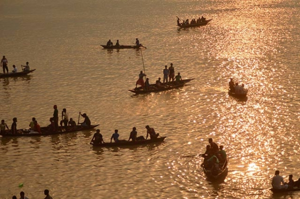 Oarsmen row boats during the traditional annual boat race festival at a Rudra Sagar lake in Melaghar, India on September 6, 2015. (Arindam Dey/AFP/Getty Images)