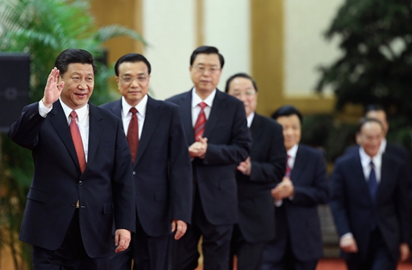 Members of China's incoming Politburo Standing Committee, led by Communist Party General Secretary Xi Jinping, greet the media at the Great Hall of the People on November 15, 2012 in Beijing. (Feng Li/Getty Images)