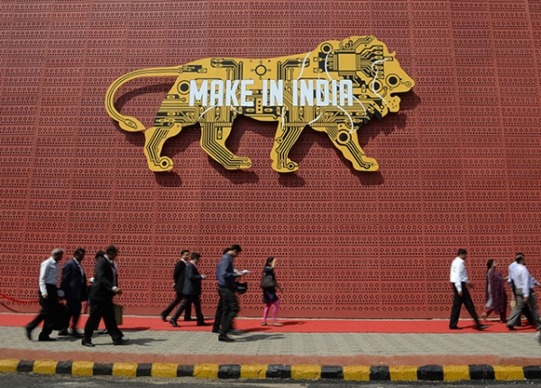 Visitors walk past one of the pavilions of the 'Make in India Week' in Mumbai on February 14, 2016. Over 190 companies, and 5,000 delegates from 60 countries, are taking part in the first 'Make in India' week held in Mumbai from February 13-18. (Indranil Mukherjee/AFP/Getty Images)