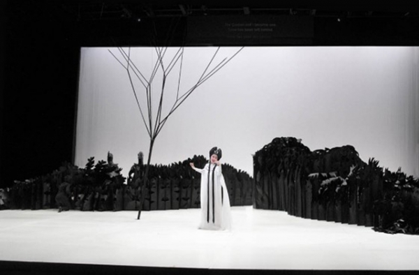 Soprano opera singer Qian Yi in front of the unique and intricate set of 'Paradise Interrupted' which is partially made of paper. (Lincoln Center Festival/Lihe Xiao)