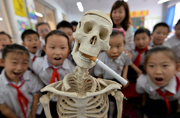 "Primary school students in Hebei, China mark ""World No Tobacco Day."" (STR/AFP/Getty Images)"