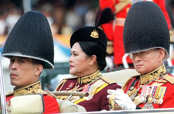 Crown Prince Vajiralongkorn (L) is poised to replace his late father, King Bhumibol Adulyajev (R), atop Thailand's monarchy. Can he be a unifying force? (Pornchai Kittiwongsakul/AFP/Getty Images)