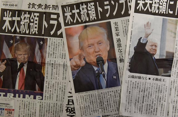 Japanese newspapers report the victory of Donald Trump in the U.S. presidential election in Tokyo on November 9, 2016. (Toru Yananaka/AFP/Getty Images)