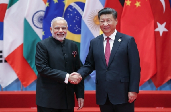 Chinese President Xi Jinping (right) shakes hands with Indian Prime Minister Narendra Modi to the G20 Summit on September 4, 2016 in Hangzhou, China. (Lintao Zhang/Getty Images)