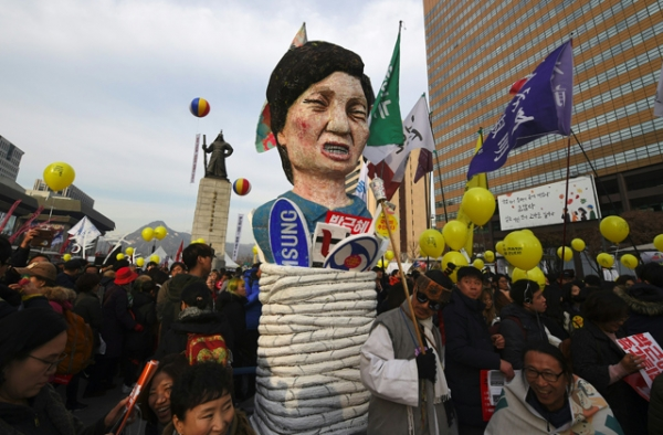 Protesters carry an effigy of South Korea's President Park Geun-Hye during a rally against Park in central Seoul on December 3, 2016. (Jung Yeon-Je/AFP/Getty Images)