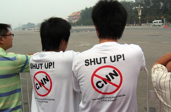 Two Chinese protesters wear anti-CNN t-shirts on Tiananmen Square in Beijing on August 8, 2008. (Robert Saiget/AFP/Getty Images)