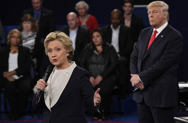 Republican nominee Donald Trump (R) watches Democratic nominee Hillary Clinton during the second presidential debate on October 9, 2016.(Saul Loeb/AFP/Getty)