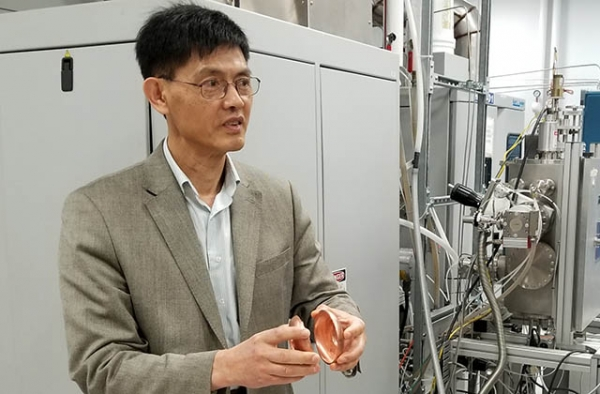Xiaoxing Xi stands in his lab. (Xiaoxing Xi)