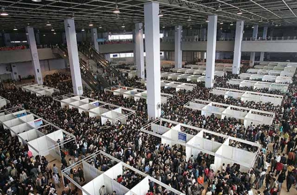 Students pack into a Chengdu, China job fair in 2005. Some 40,000 students competed for 10,000 jobs at the fair. (China Photos/Getty Images)