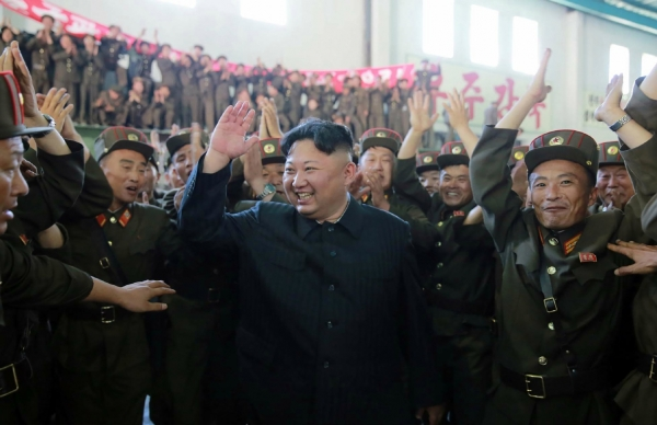 Kim Jong-Un (C) celebrates the successful test-fire of the intercontinental ballistic missile Hwasong-14 at an undisclosed location. (SPR/AFP/Getty Images)