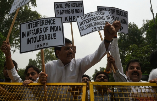 Indian activists of National Panthers Party shout anti Chinese slogans during a protest near the Chinese embassy in New Delhi on July 7, 2017. (Money Sharma/AFP/Getty Images)