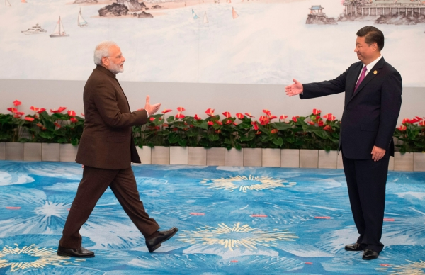 Chinese President Xi Jinping (R) welcomes Indian Prime Minister Narendra Modi for a banquet dinner during the BRICS Summit in Xiamen, Fujian province on September 4, 2017. (Fred Dufour/AFP/Getty Images)