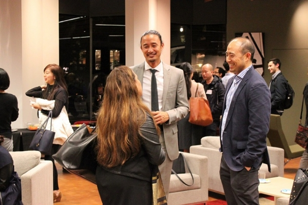 Brian Reyes, Chair of the Young Professionals Group and Asahi Choi, Financial Chair for YPG, chat with an attendee. (Asia Society)
