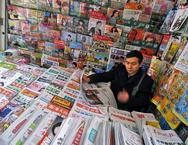 Catching up with the morning's headlines in a stall in Guangzhou, China on March 24, 2012. (r s gould/Flickr)