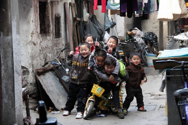 Children horsing around during their day off from school in Shanghai on March 10, 2012. (jijis/Flickr)