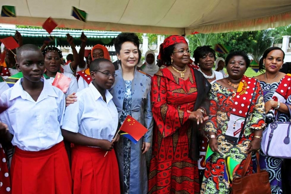 China's First Lady, Peng Liyuan (L), and her Tanzanian counterpart Salma Kikwete (R) on a joint visit to the Wanawake na Maendeleo Foundation (WAMA) offices in Dar Es Salaam, Tanzania, on March 25, 2013. (John Lukuwi/AFP/Getty Images)