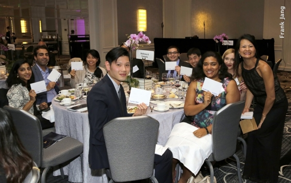 Annual Dinner guests celebrate winning the surprise Southwest Airlines drawing with Kim Delevett, Southwest Airlines (Frank Jang Asia Society)