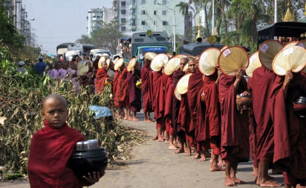 Buddhist monks make their way through the streets to collect offerings in Yangon on May 8, 2009. (Hla Hla Htay/AFP/Getty Images)