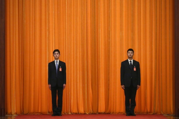 Two soldiers dressed as ushers guard in front of a curtain during a meeting of the opening session of the 18th Communist Party Congress at the Great Hall of the People on November 9, 2012 in Beijing, China. (Feng Li/Getty Images)