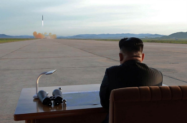 North Korean leader Kim Jong-Un watches a launching drill of the medium-and-long range strategic ballistic rocket Hwasong-12. (STR/AFP/Getty)