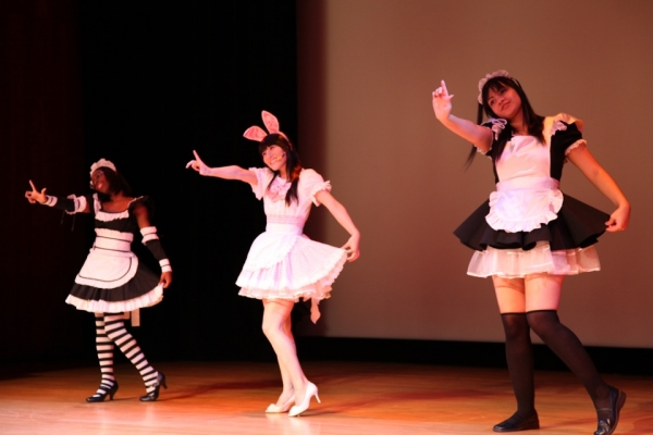 "Cosplay singer and judge Reni Mimura (center) performs her opening number, ""Kitty-chan."" (Leah Thompson/Asia Society)"