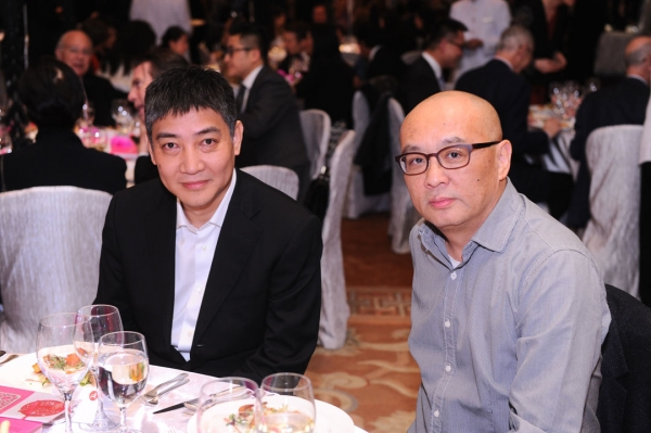 (Left to right) Leng Lin of Pace Gallery Beijing and artist Zhang Xiaogang at the 2015 gala.