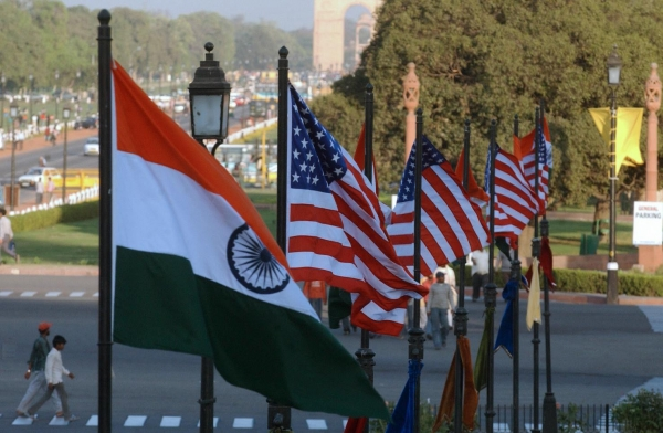 U.S. and Indian flags fly on Rajpath in front of India Gate in New Delhi, India. (Manpreet Romana/AFP/Getty Images)