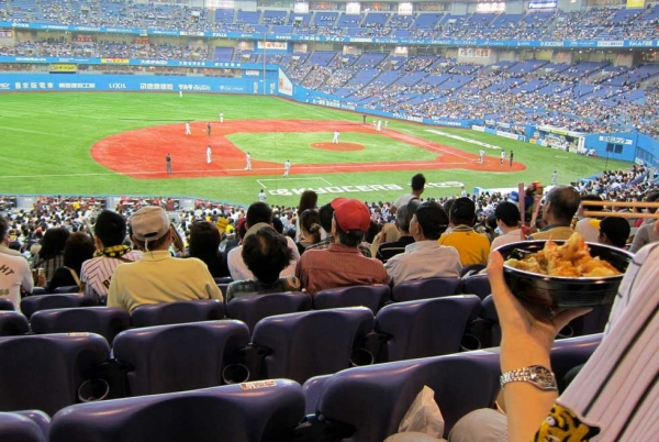 A fan enjoys his tempura in the Osaka baseball stadium. (wallyg/Flickr)