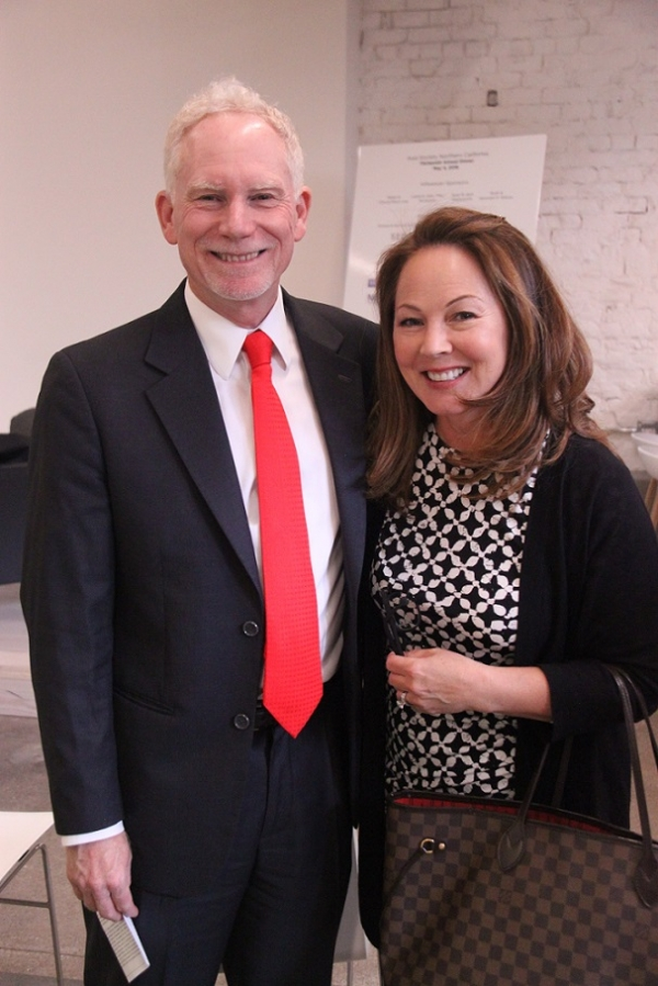 N. Bruce Pickering, Executive Director of Asia Society Northern California, smile for the camera with Sydnie Kohara, ASNC Advisory Board Member and Former Anchor CBS 5. (Asia Society)