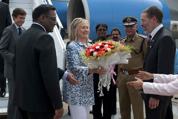 US Secretary of State Hillary Clinton (C) receives flowers after disembarking from her plane upon her arrival in Chennai, India on July 20, 2011. (Saul Loeb/AFP/Getty Images)