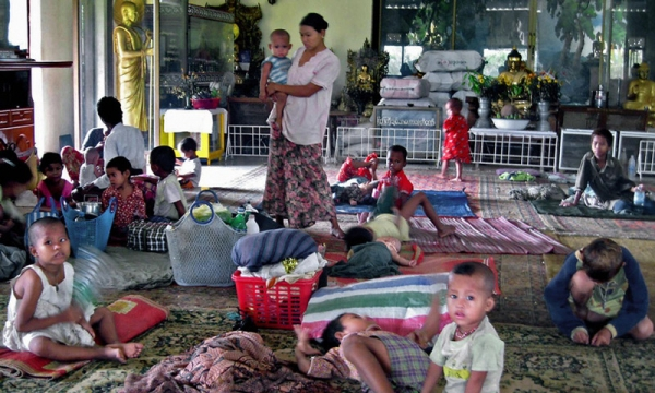 Displaced residents who lost their homes take shelter in a Buddhist temple in Yangon on May 5, 2008. (Hla Hla Htay/AFP/Getty Images)