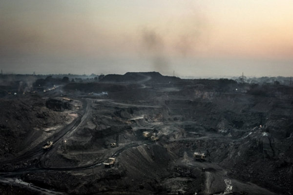 An open-air mine near Dhanbad runs 24 hours a day extracting coal. (Erik Messori)