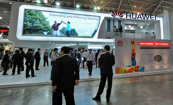 People visiting Huawei Technologies booth display of its product during CommunicAsia 2010 conference and exhibtion show in Singapore. (Roslan Rahman/AFP/Getty Images)