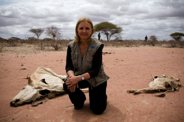 Josette Sheeran during an interview near carcasses of animals that died because of drought in Wajir, northeastern Kenya, on July 23, 2011. (WFP/Siegfried Modola)