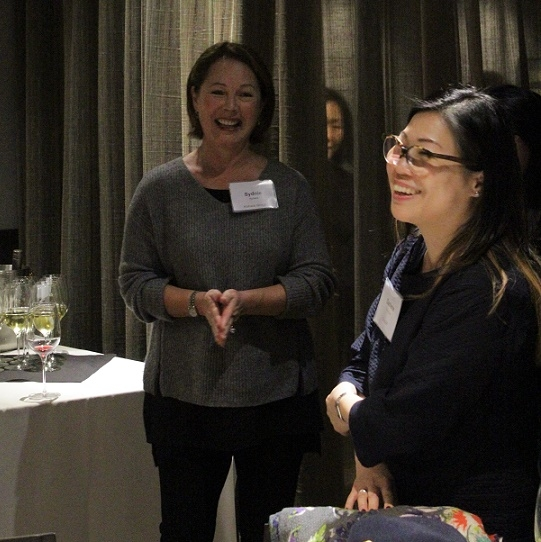 Sydnie Kohara, member of the ASNC Advisory Board and Darlene Chiu Bryant of ChinaSF laugh before dinner starts (Stesha Marcon)